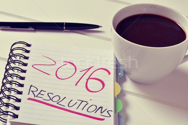 coffee and notepad with the text 2016 resolutions Stock photo © nito