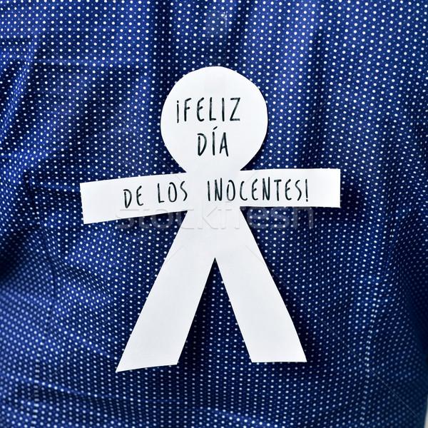 paper man with the text feliz dia de los inocentes, happy innoce Stock photo © nito