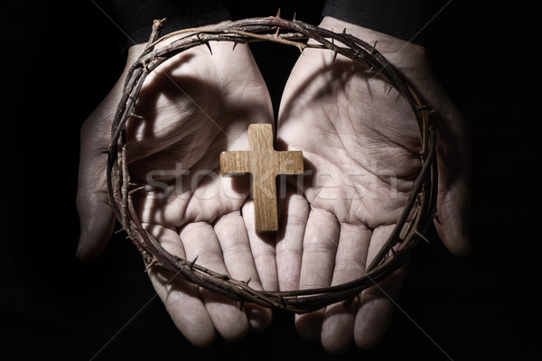 Stock photo: man with a cross and a crown of thorns