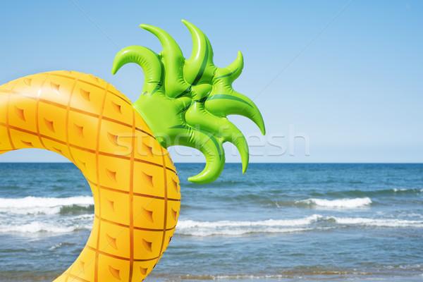 pineapple swim ring on the beach Stock photo © nito