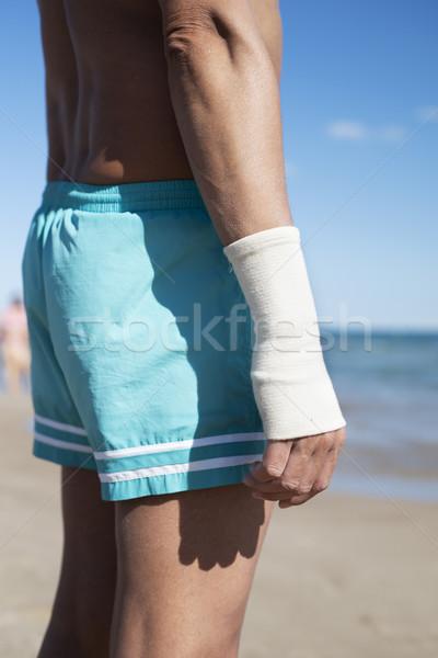 Adam plaj bandaj bilek genç Stok fotoğraf © nito