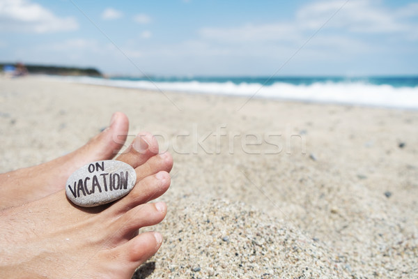 man on the beach and text on vacation Stock photo © nito