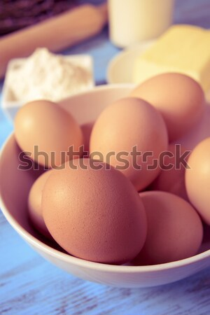 eggs, butter, flour and milk on a blue wooden table Stock photo © nito