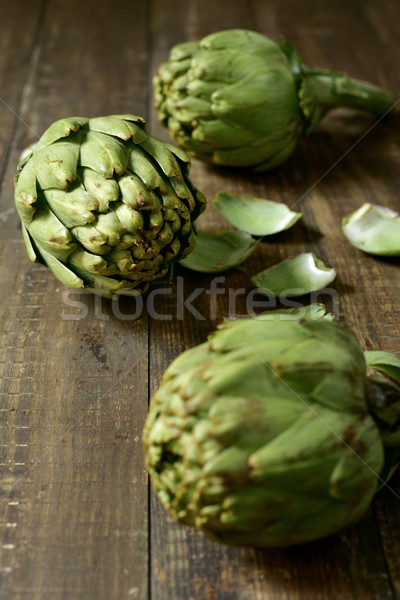 raw artichokes on a wooden surface Stock photo © nito