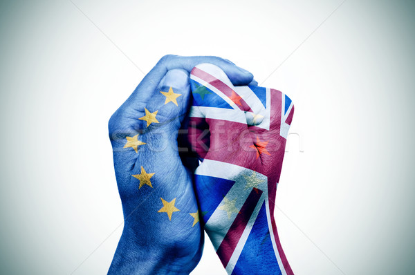 hands patterned with the European and the British flag put toget Stock photo © nito