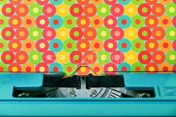 colorful circles-patterned paper in a blue typewriter Stock photo © nito