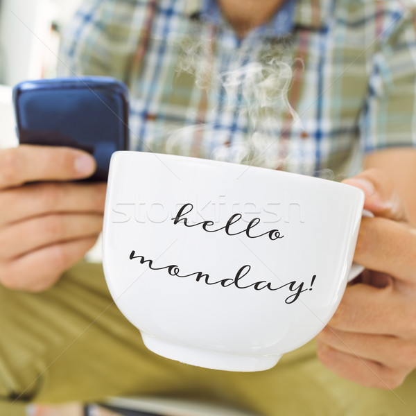 young man with a cup with the text hello monday Stock photo © nito