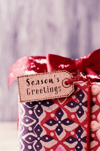gift with a label with the text seasons greetings Stock photo © nito