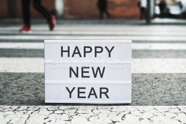 text happy new year in a lightbox on the asphalt Stock photo © nito