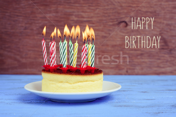text happy birthday and cheesecake with lighted candles Stock photo © nito
