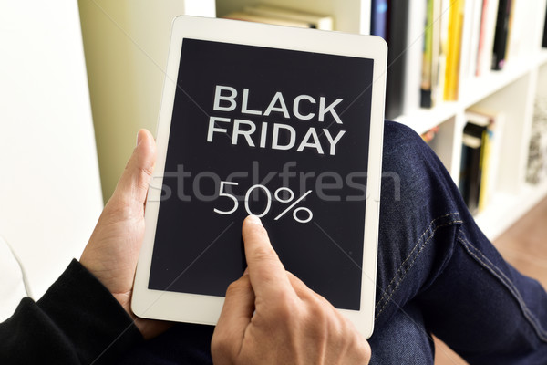 young man with a tablet with the text black friday Stock photo © nito