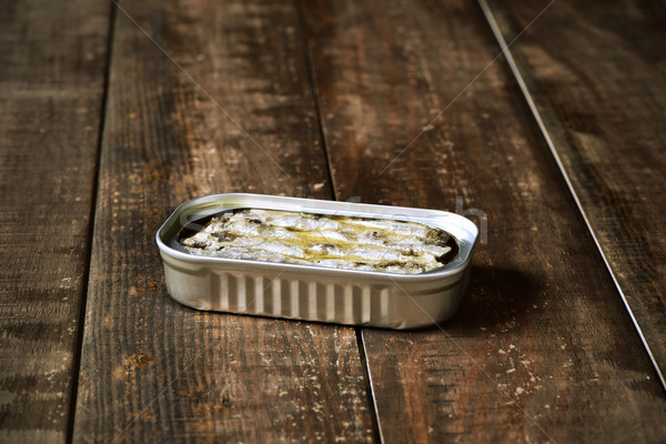 sardine can on a wooden surface Stock photo © nito