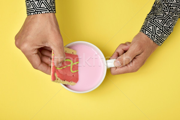 man soaking a pink biscuit in a pink milkshake Stock photo © nito