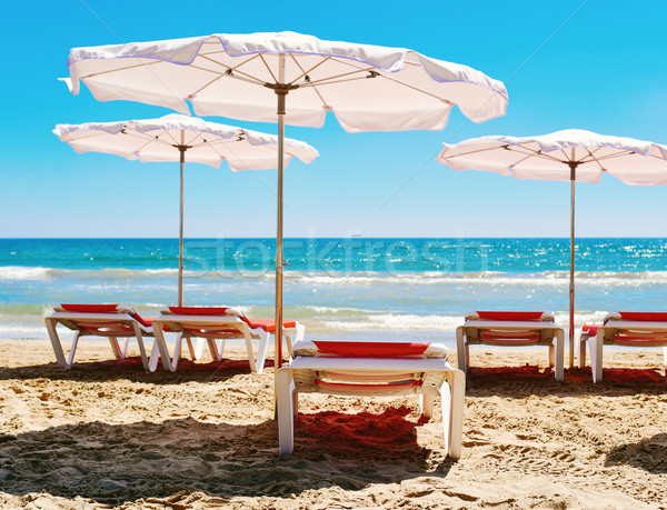 sunloungers and umbrellas in a quiet beach Stock photo © nito