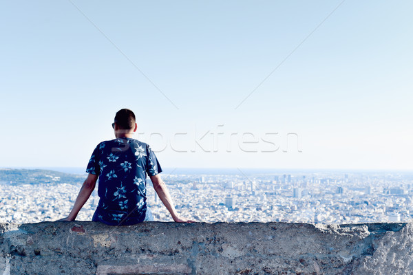 young man with the city bellow him Stock photo © nito