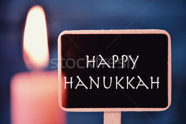 lit candle and text happy Hanukkah Stock photo © nito