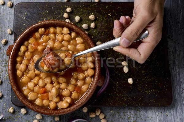 Spagnolo spezzatino tipico Madrid shot mano Foto d'archivio © nito