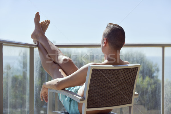 young man sun tanning in a chair Stock photo © nito