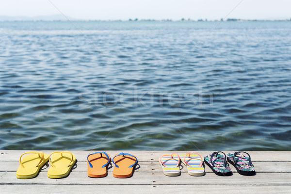 pairs of flip-flops on a pier Stock photo © nito