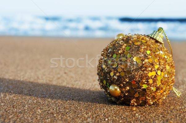 christmas ball on the sand of a beach Stock photo © nito