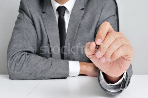man in suit with a pen Stock photo © nito