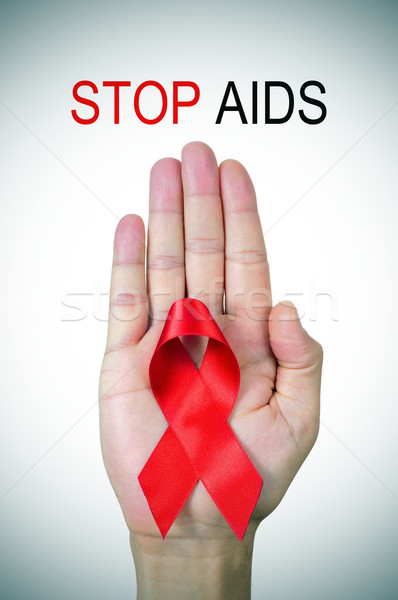 text stop AIDS and a red ribbon in a man hand Stock photo © nito