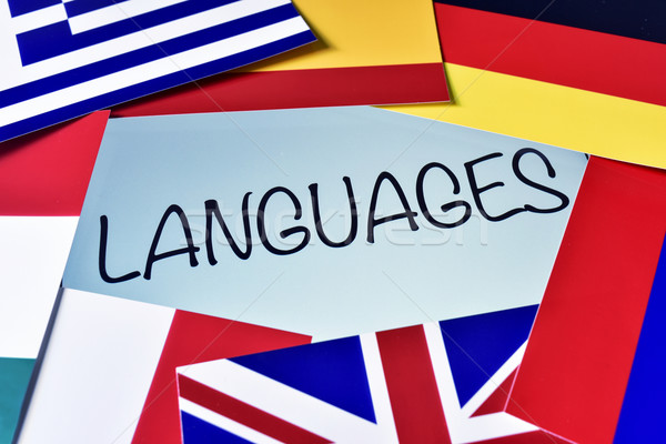 different flags and the word languages in the screen of a tablet Stock photo © nito