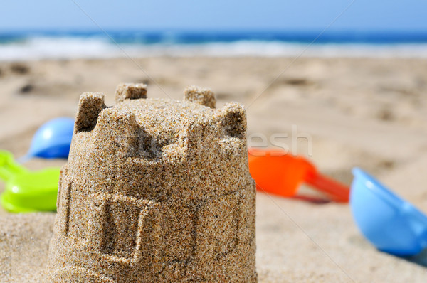 sandcastle and toy shovels on the sand of a beach Stock photo © nito