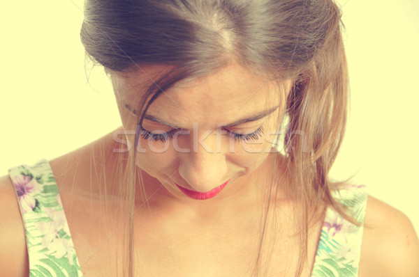 young brunette woman looking downwards Stock photo © nito