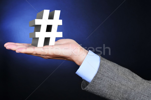 businessman with a 3D hash sign in his hand Stock photo © nito