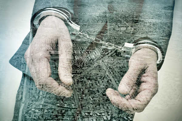 double exposure of a handcuffed man and tract housing developmen Stock photo © nito