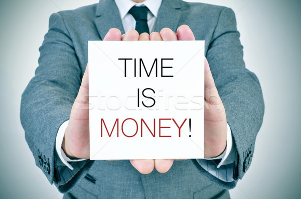 businessman with signboard with text time is money Stock photo © nito