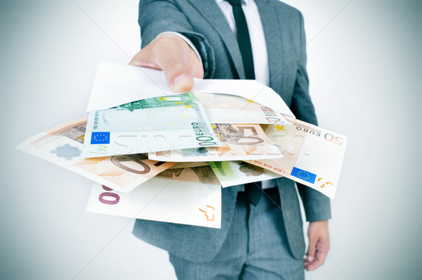 man giving an envelope full of euro bills Stock photo © nito