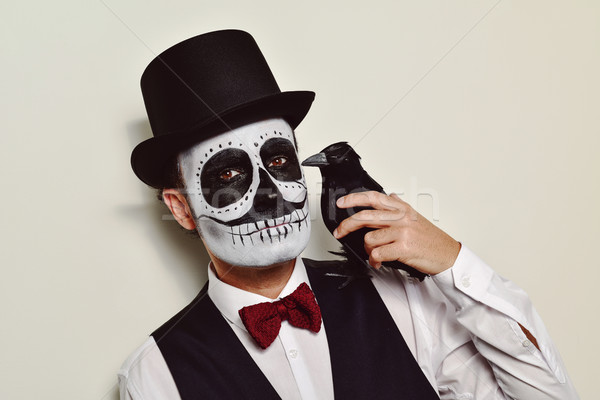 man with calaveras makeup and a black crow Stock photo © nito