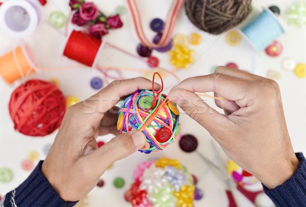 Férfi készít kézzel készített karácsony labda közelkép Stock fotó © nito
