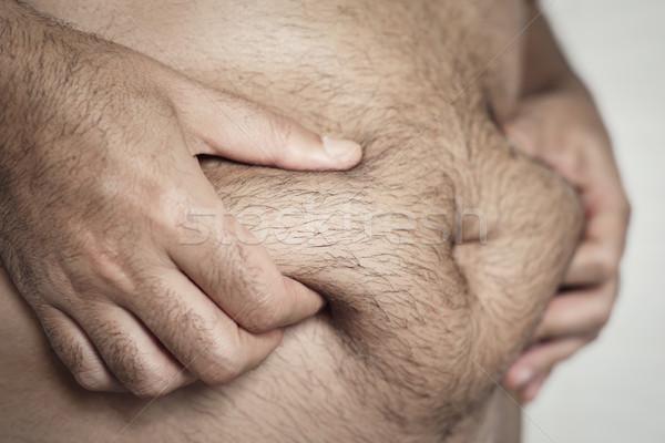 Uomo grasso stomaco primo piano giovani Foto d'archivio © nito