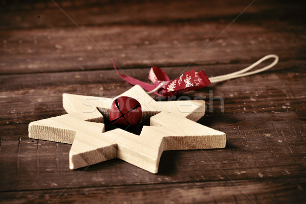 wooden christmas star on a rustic wooden surface Stock photo © nito