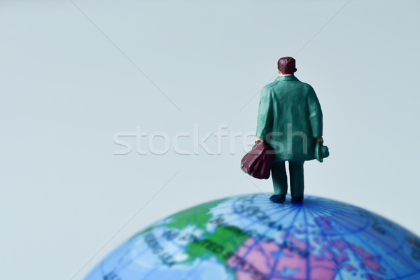 miniature traveler man on the terrestrial globe Stock photo © nito