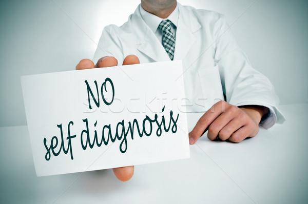 Não diagnóstico homem branco casaco Foto stock © nito