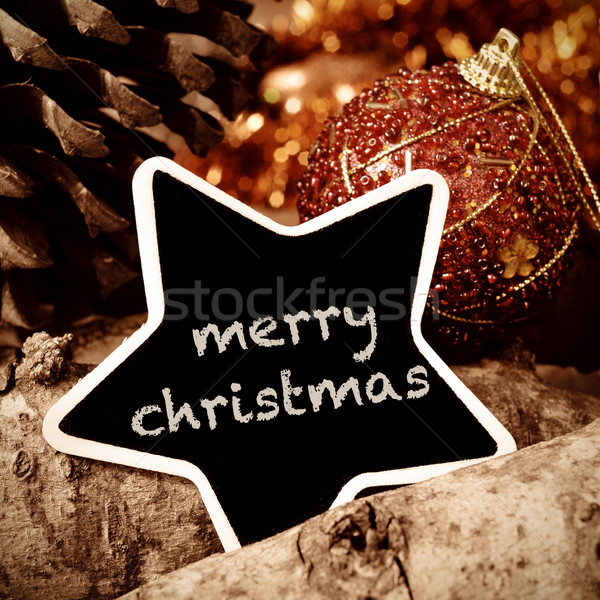 text merry christmas in a star-shaped chalkboard on a rustic bac Stock photo © nito