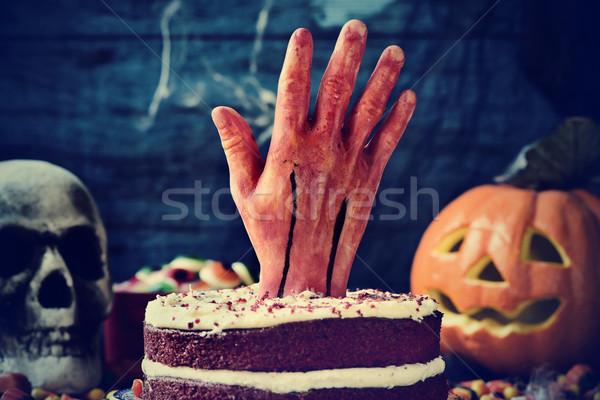 Bolo sangrento mão assustador cena halloween Foto stock © nito