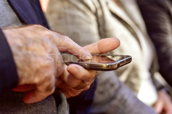 old man using a smartphone Stock photo © nito