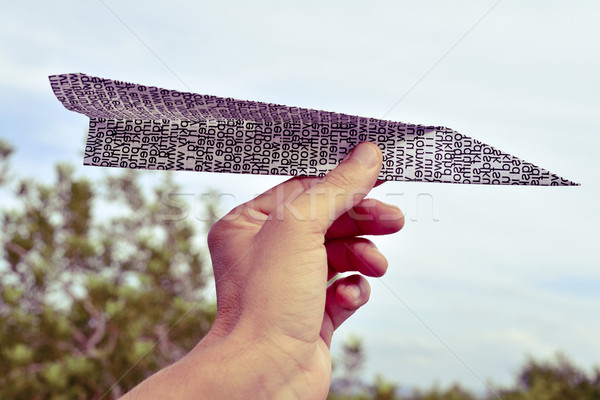 young man launching a paper plane Stock photo © nito