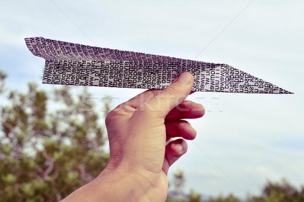 молодым человеком бумаги плоскости стороны молодые Сток-фото © nito