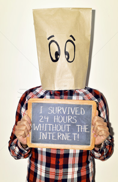 Stock photo: man and text I survived 24 hours without the internet