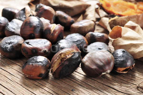 roasted chestnuts on a rustic wooden table Stock photo © nito