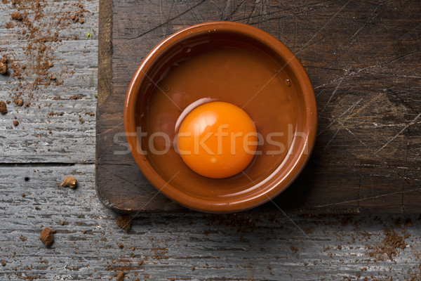 cracked chicken egg on a wooden table Stock photo © nito
