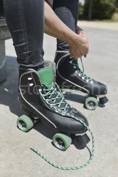 young man tying his roller skates Stock photo © nito