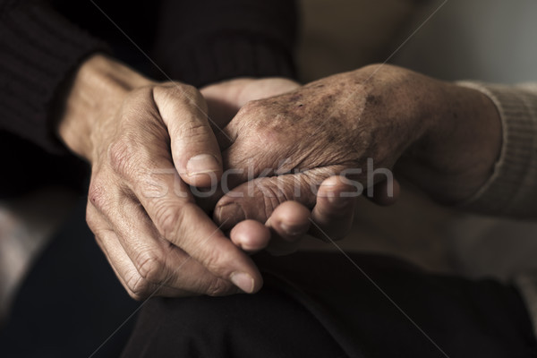 young man holding the hand of an old woman Stock photo © nito