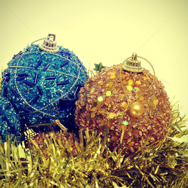 christmas ball and golden tinsel with a retro effect Stock photo © nito